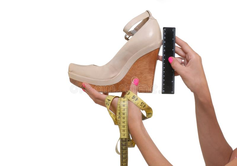 Measuring of high heel on fashion shoes.  stock photo