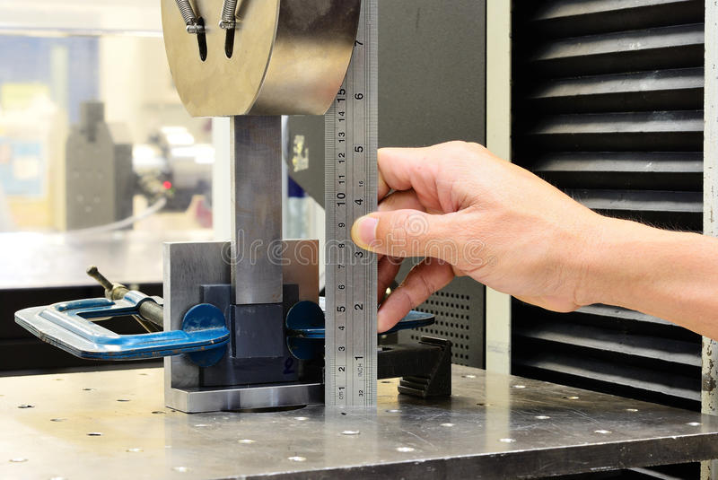 Measuring on the jig fixture shear stress specimen before test. On testing machine stock image
