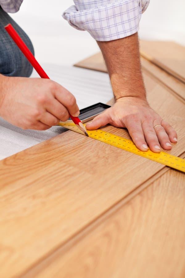 Measuring laminate flooring plancks stock photos