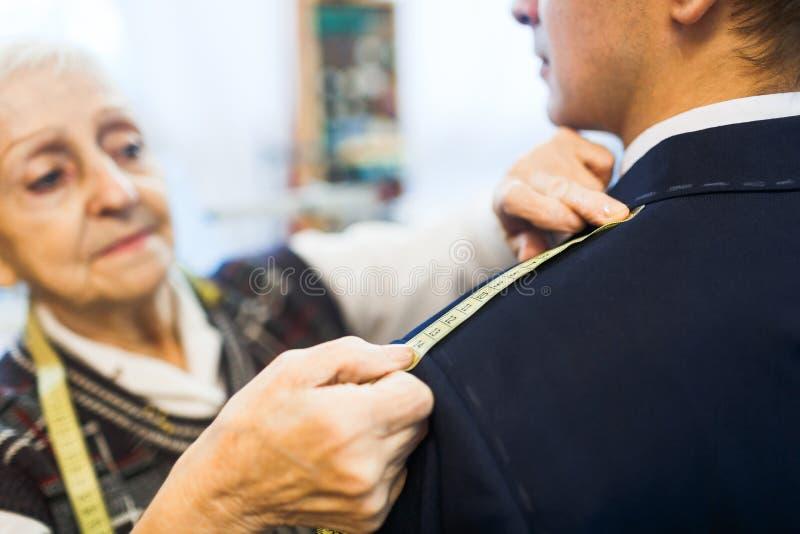 Measuring length of jacket shoulder royalty free stock photo