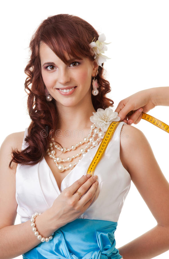 Measuring length from shoulder to breast close-up royalty free stock photo