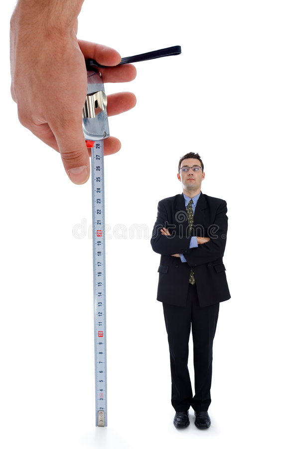 Measuring a men. Metaphoric view of a test before employment royalty free stock photography