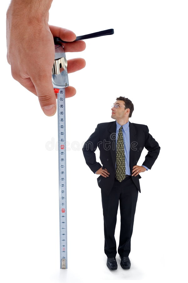 Measuring a men. Metaphoric view of a test before employment stock photos
