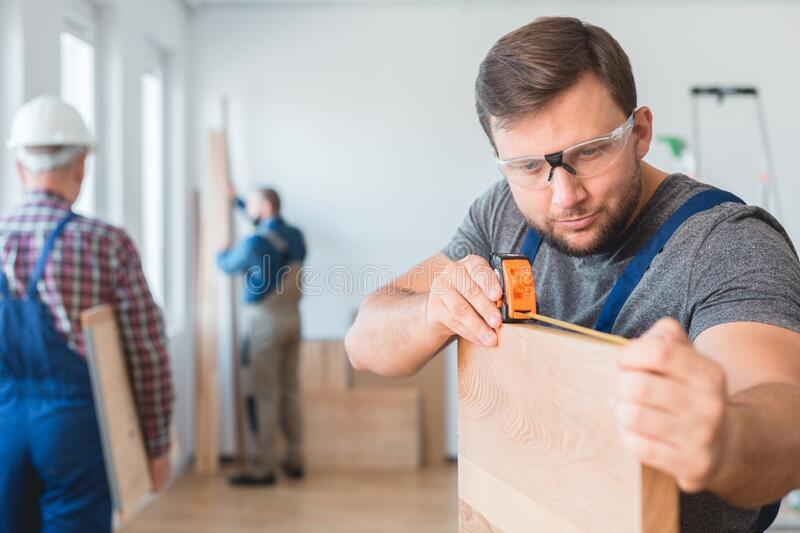 Measuring off the wood stock photos