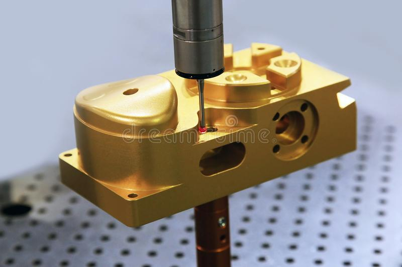 Measuring part dimensions. Auto measuring machine CMM Measuring dimension of precision part auto probe touching stock photo