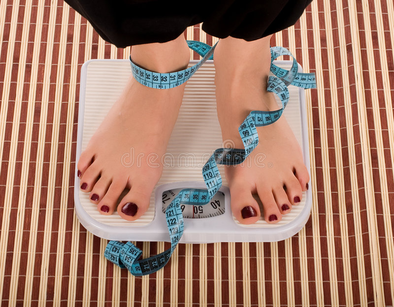 Download On measuring scale stock photo. Image of lifestyle, unhealthy - 4911374