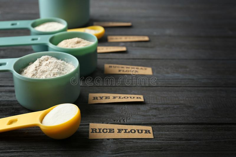 Measuring scoops with different types of flour royalty free stock images
