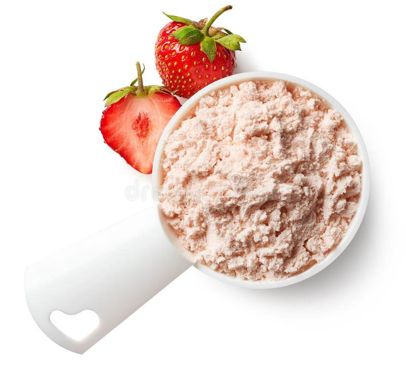 Measuring spoon of strawberry protein powder stock photography