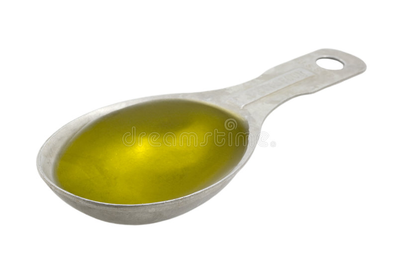 Measuring tablespoon of olive oil. Isolated on white, clipping paths included stock photos