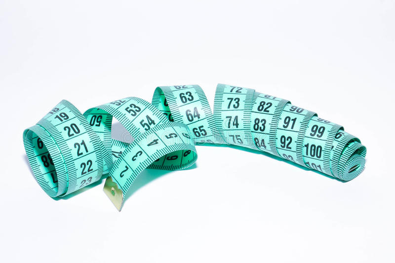 Measuring tape. A blue measuring tape on a white background stock photography