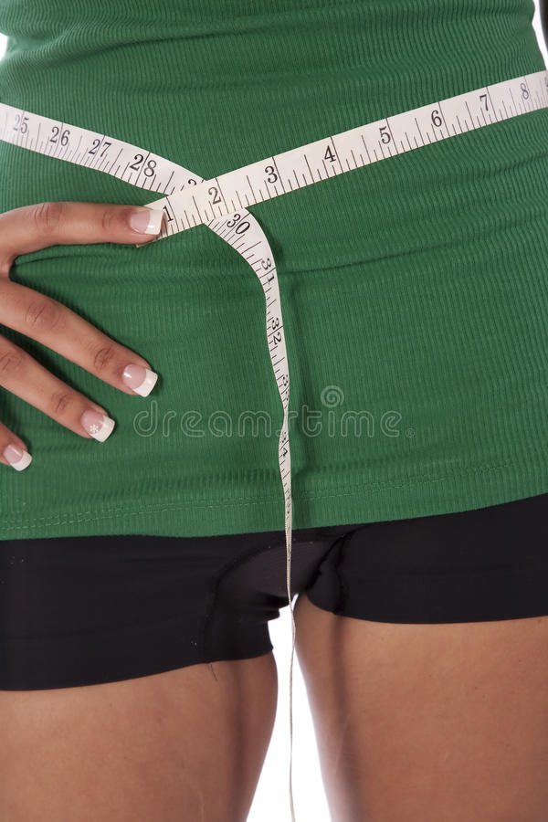 Measuring tape close up on waist royalty free stock image