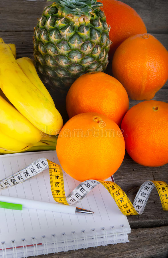 Measuring tape fruit dhealthy diet weight loss stock photography