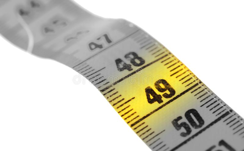 Measuring tape, selective focus on 49. Measuring tape isolated on white, selective focus on 49 royalty free stock images