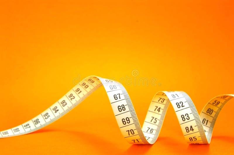 Measuring Tape on Orange stock photos