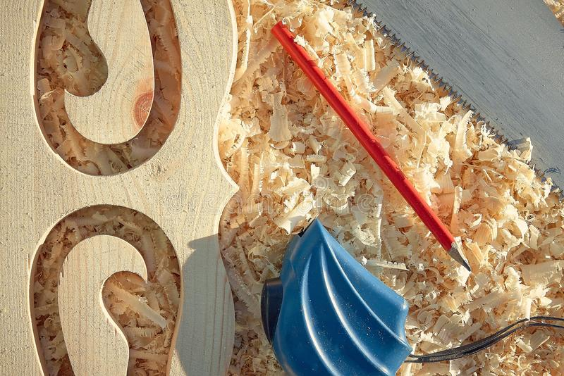 Measuring tape and pencil important tools when sawing wood boards and platbands royalty free stock photography