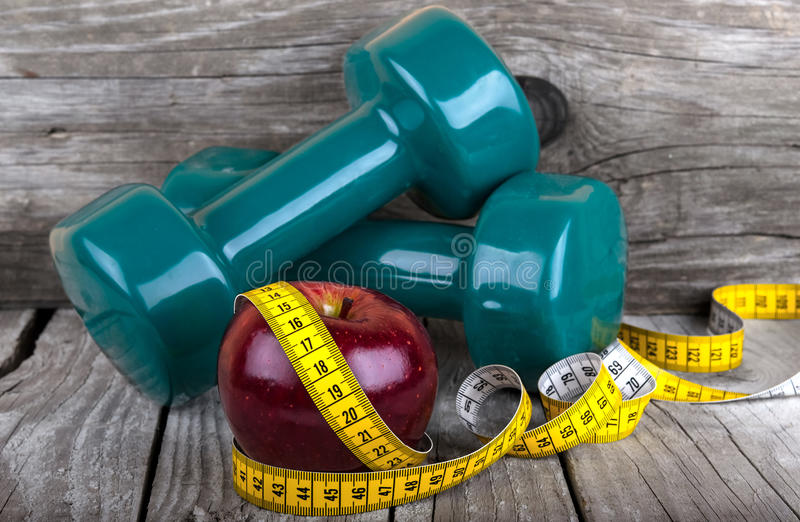 Measuring tape wrapped around a apple weight loss. Photo royalty free stock photography
