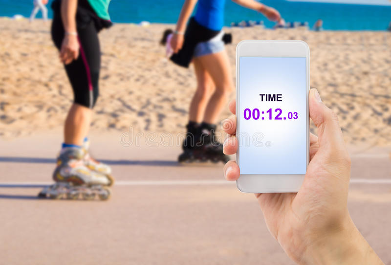 Measuring the time with my smartphone royalty free stock photo