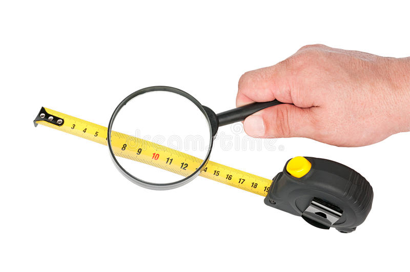 Measuring Tool A Roulette  And Magnifier In Hand Stock Photo