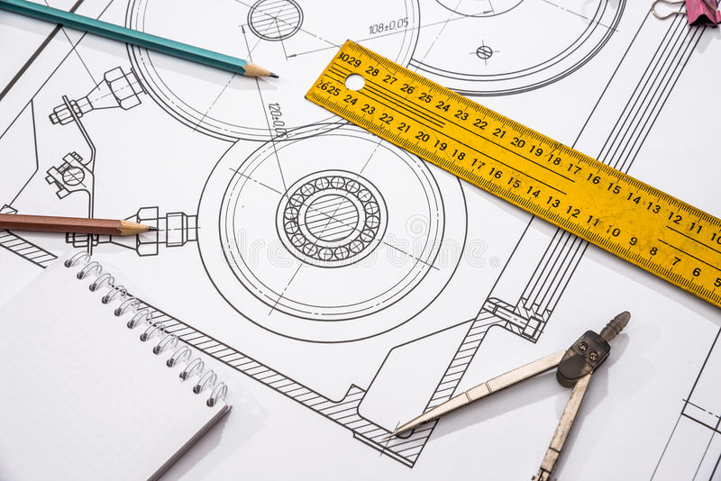 Measuring tools on the background of technical drawings. View on top royalty free stock image