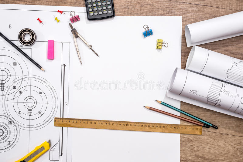 Measuring tools on the background of technical drawings. View on top royalty free stock images