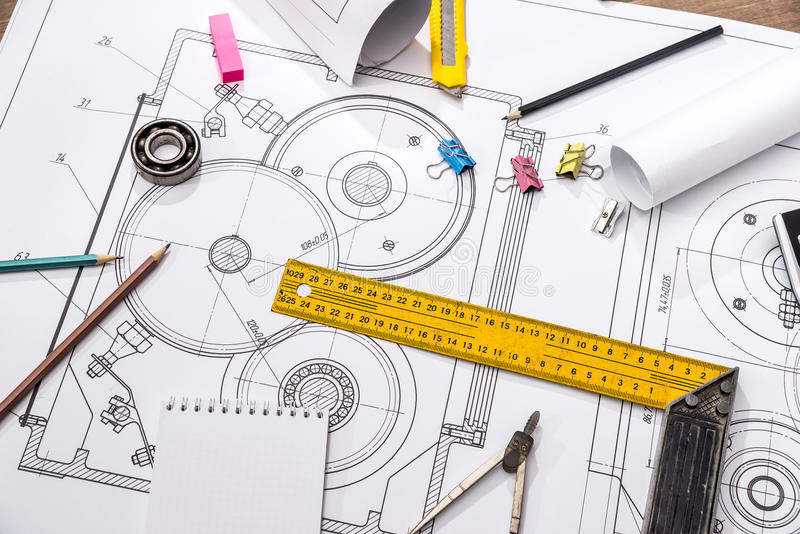 Measuring tools on the background of technical drawings. View on top royalty free stock photo