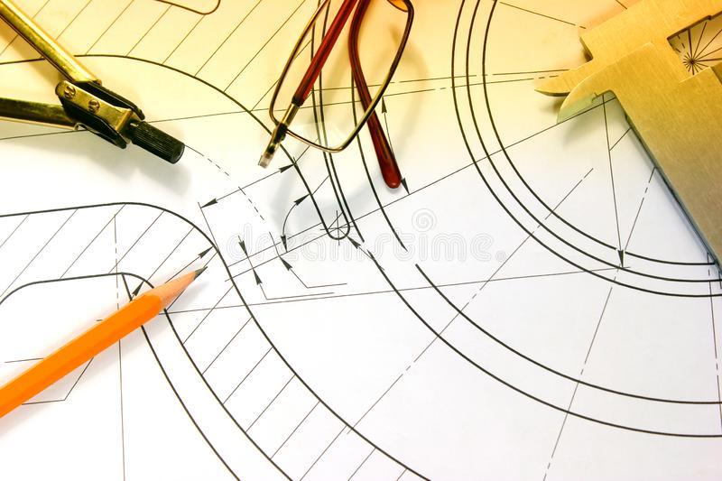 Measuring tools scattered in the drawing, engineering work. On the project royalty free stock image