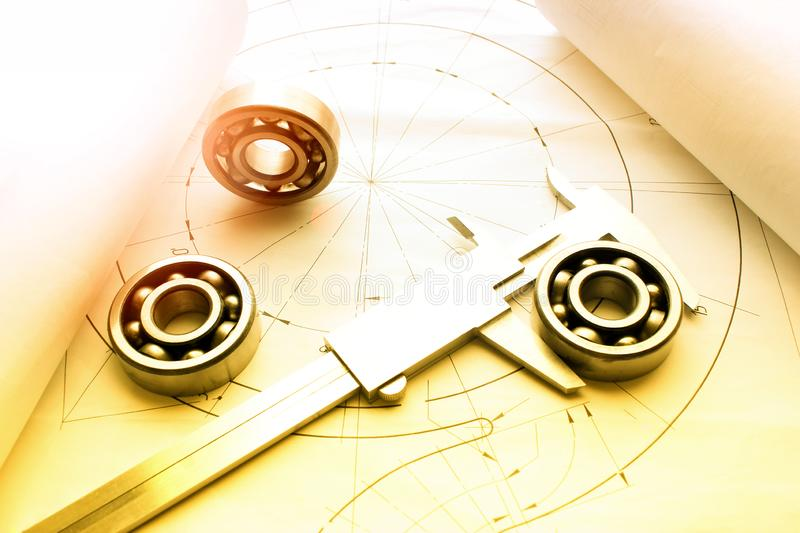 Measuring tools scattered in the drawing, engineering work on the project, bearing. Scattered in the drawing royalty free stock photos