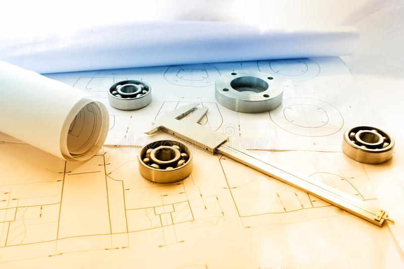 Measuring tools scattered in the drawing, engineering work on the project, bearing. Tools scattered in the drawing royalty free stock image