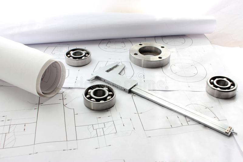 Measuring tools scattered in the drawing, engineering work on the project, bearing. Measuring tools scattered royalty free stock photo