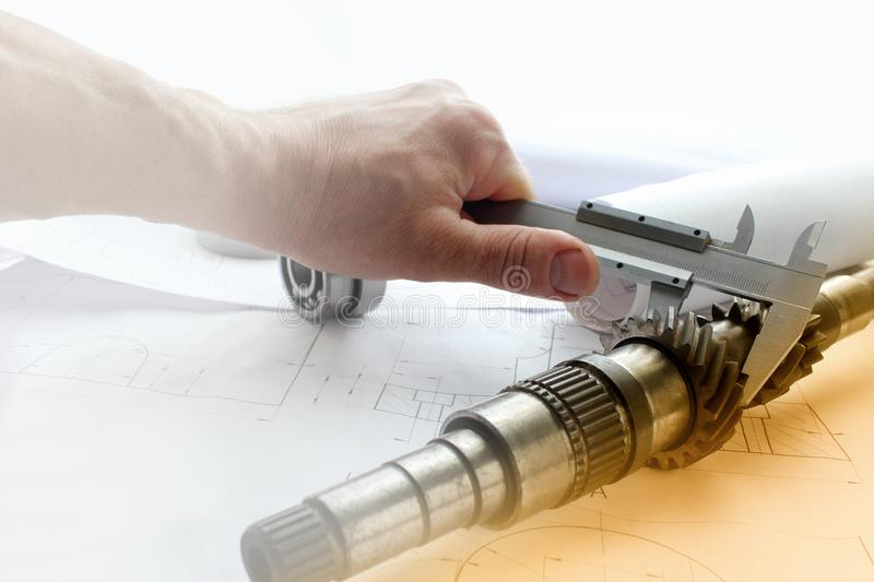 Measuring tools scattered in the drawing, engineering work on the project, bearing. Measuring tools scattered stock photo