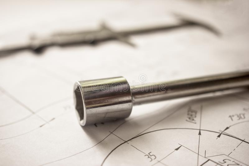 Measuring tools scattered in the drawing, engineering work on the project, bearing. Measuring tools scattered in the drawing royalty free stock photography