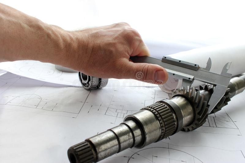 Measuring tools scattered in the drawing, engineering work on the project, bearing. Measuring tools scattered royalty free stock photos