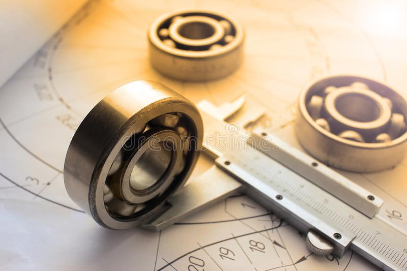 Measuring tools scattered in the drawing, engineering work on the project, bearing. Measuring tools scattered in the drawing royalty free stock photos