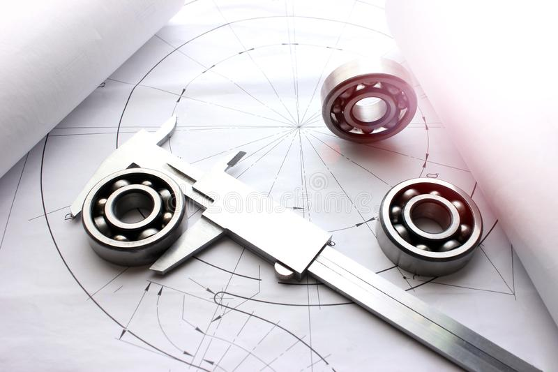 Measuring tools scattered in the drawing, engineering work on the project, bearing. Scattered in the drawing royalty free stock photography