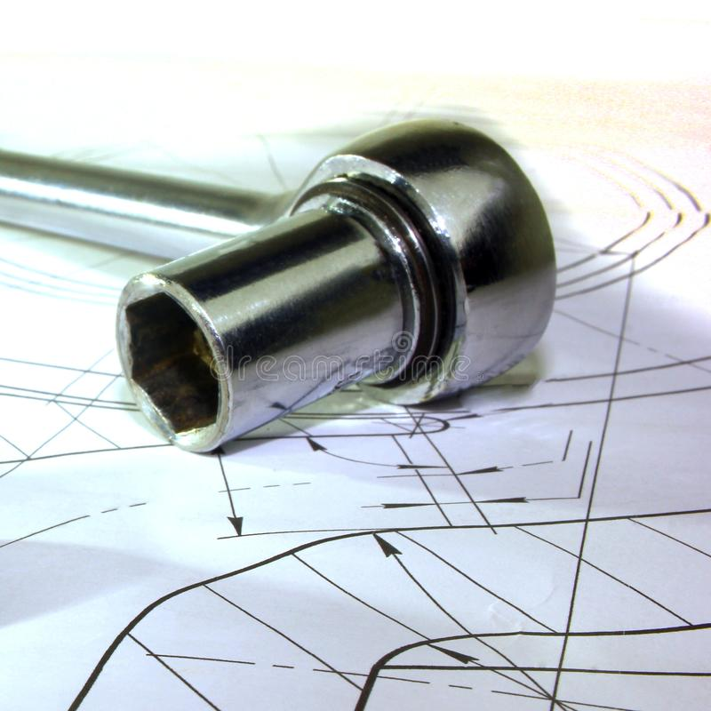 Measuring tools scattered in the drawing, engineering work. On the project royalty free stock photography