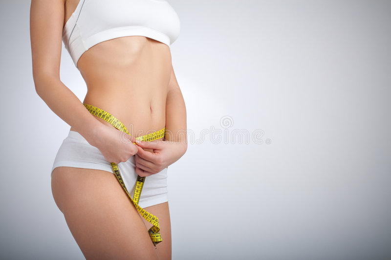 Measuring waist stock images