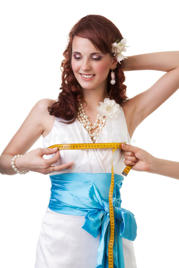 Measuring waist of a bride stock image