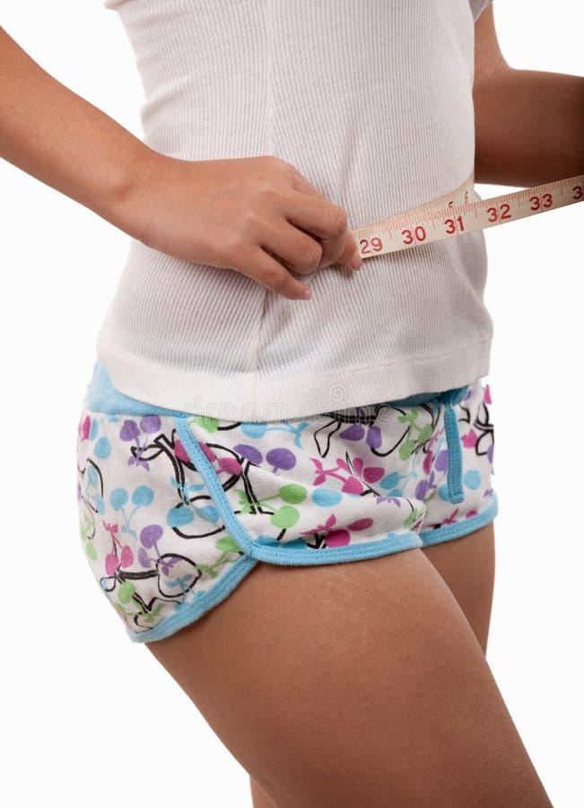 Measuring the waistline stock image