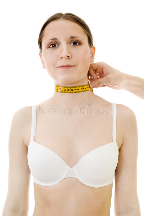 Measuring woman's neck length royalty free stock photos