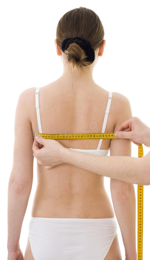 Measuring woman's shoulder-blade distance stock photography