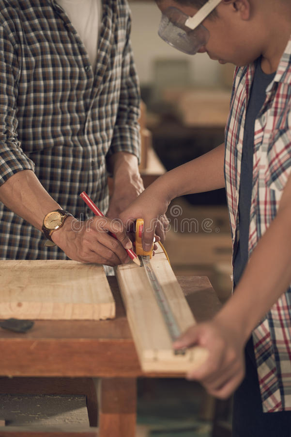 Measuring wooden plank stock images