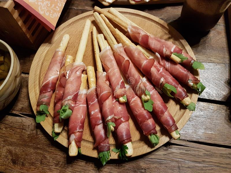 Meat appetizer on sticks. European food. Hamon. royalty free stock photos