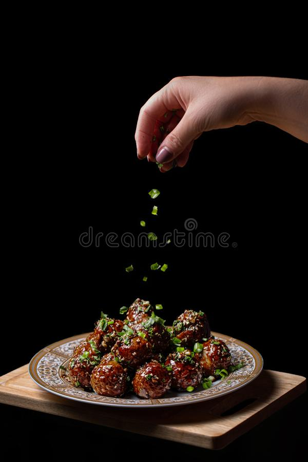 Meat balls with quail egg inside, on a black background royalty free stock images