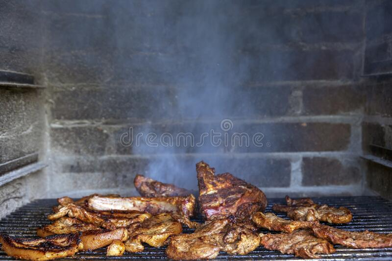Meat on the barbecue grill stock photo