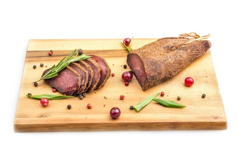 Meat basturma cutting on the board royalty free stock photography