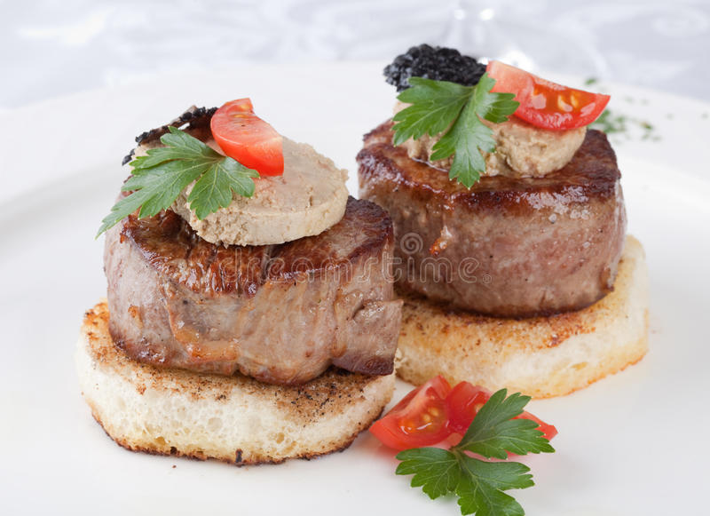 Meat beef with fua-gra. And truffles royalty free stock photography