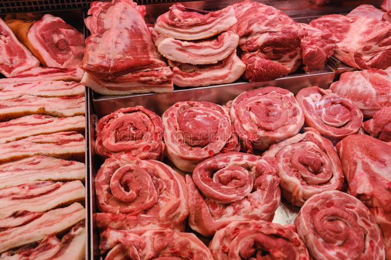 Meat beef and pork sold on the counter at in refrigerator supermarket stock image