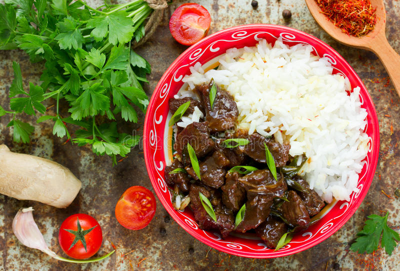 Meat beef in soy sauce, garlic and ginger. Eastern cuisine. Mongolian meat stock images
