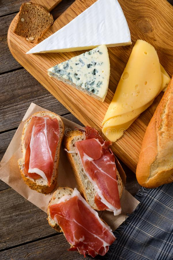 Meat, bread and various cheeses stock image