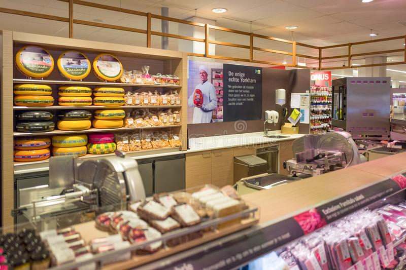 Meat and cheese department in an Albert Heijn store. stock photo